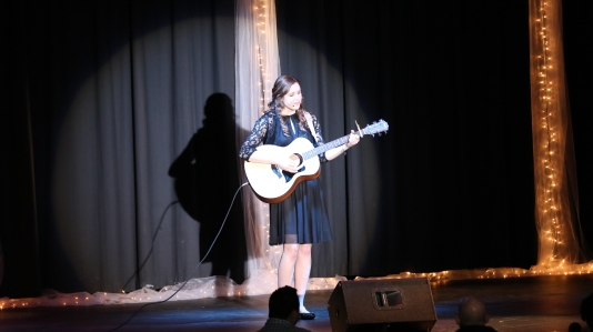 Olivia Spain captures hearts with an original song.