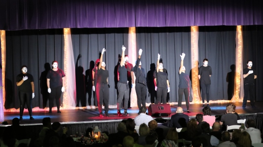"Village mime team performs ""The Hill""."